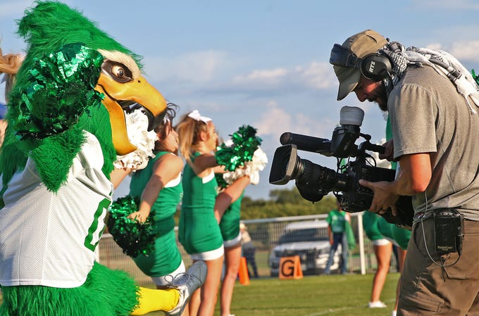 A camera operator with Fox Sports Southwest records footage of the Wall mascot before the start of the season opener against Mason on Thursday, August 29, 2019.