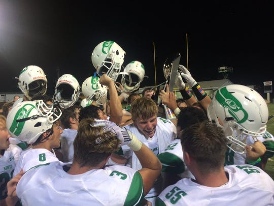 The Wall Hawks football team celebrates its 47-7 win over the Mason Punchers on Thursday, Aug. 29, 2019 in Mason.