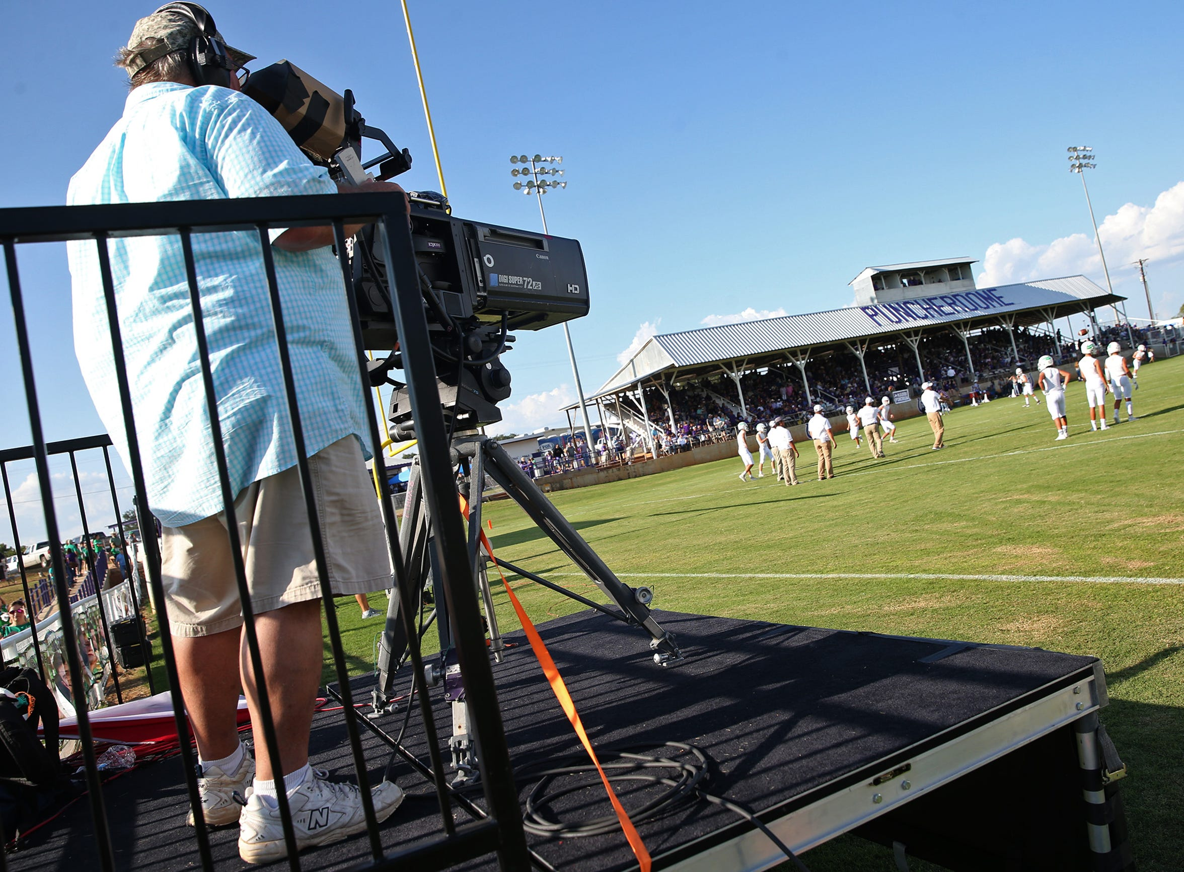 A camera operator with Fox Sports Southwest records a warmup before the start of the game between Mason and Wall on Thursday, August 29, 2019.