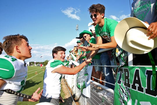 A Wall fan talks to Kye Herbert, far left, prior to the start of the game against Mason on Thursday, August 29, 2019.