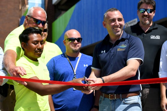 Mayor Jake Day and other project organizers cut the ribbon, officially celebrating the new food truck pad on Friday, Aug. 30, 2019.