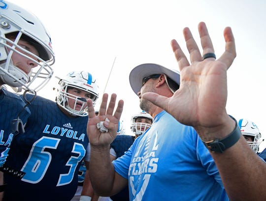 Loyola coach Steven Geter talks with Thomas Murphy during Thursday's jamboree with Red River.