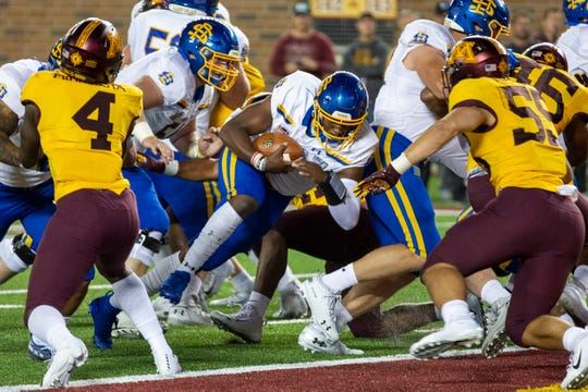 Aug 29, 2019; Minneapolis, MN, USA; South Dakota State Jackrabbits quarterback J'Bore Gibbs (2) rushes for a touchdown in the first half against the Minnesota Golden Gophers at TCF Bank Stadium. Mandatory Credit: Jesse Johnson-USA TODAY Sports