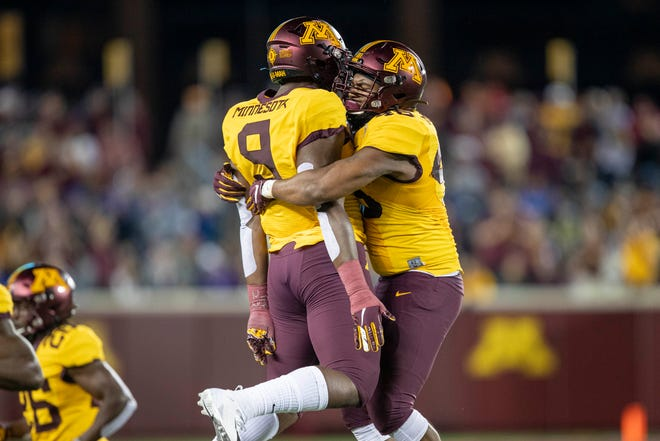 Aug 29, 2019; Minneapolis, MN, USA; Minnesota Golden Gophers defensive lineman Winston DeLattiboudere (46) celebrates with Minnesota Golden Gophers defensive lineman Esezi Otomewo (9) after recovering a fumble in the second half against the South Dakota State Jackrabbits at TCF Bank Stadium. Mandatory Credit: Jesse Johnson-USA TODAY Sports