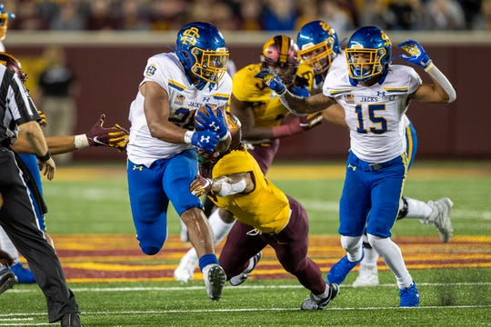 Aug 29, 2019; Minneapolis, MN, USA; South Dakota State Jackrabbits running back Mikey Daniel (26) rushes with the ball in the second half against the Minnesota Golden Gophers at TCF Bank Stadium. Mandatory Credit: Jesse Johnson-USA TODAY Sports