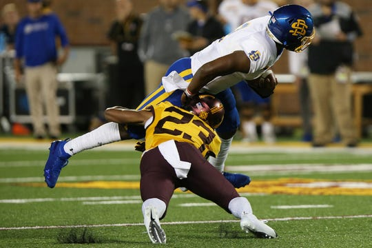 Minnesota defensive back Jordan Howden (23) tackles South Dakota State quarterback J'Bore Gibbs during an NCAA college football game Thursday, Aug. 29, 2019, in Minneapolis. Minnesota won 28-21. (AP Photo/Stacy Bengs)