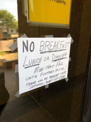 A sign on the door of the Union Gospel Mission men's center explains the temporary change in meal service after a cook unexpectedly quit.