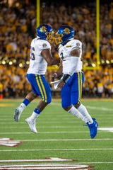 Aug 29, 2019; Minneapolis, MN, USA; South Dakota State Jackrabbits quarterback J'Bore Gibbs (2) celebrates with running back Mikey Daniel (26) after scoring a touchdown in the first half against the Minnesota Golden Gophers at TCF Bank Stadium. Mandatory Credit: Jesse Johnson-USA TODAY Sports