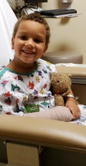 Avera staff bandaged up Bentleigh Dougherty's teddy bear's arm after 6-year-old Dougherty broke his arm.