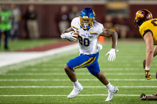 Aug 29, 2019; Minneapolis, MN, USA; South Dakota State Jackrabbits running back Pierre Strong Jr. (20) rushes with the ball for a first down in the second half against the Minnesota Golden Gophers at TCF Bank Stadium. Mandatory Credit: Jesse Johnson-USA TODAY Sports