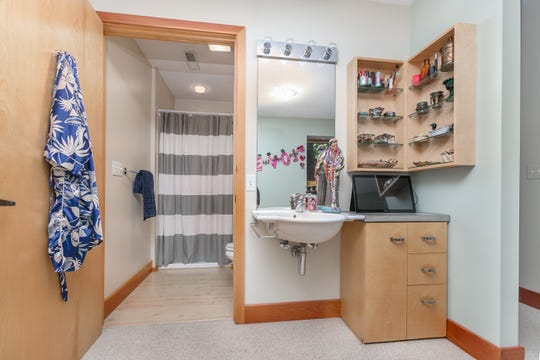 The bathroom is amply sized, and the light woodwork keeps the space bright.