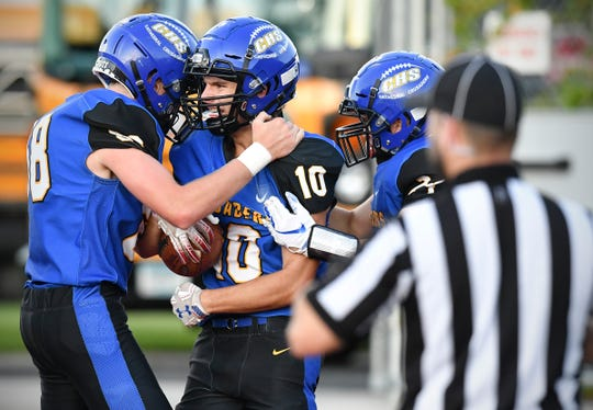 Cathedral players celebrate a touchdown in the first half during the Thursday, Aug. 29, 2019, game at Husky Stadium in St. Cloud.
