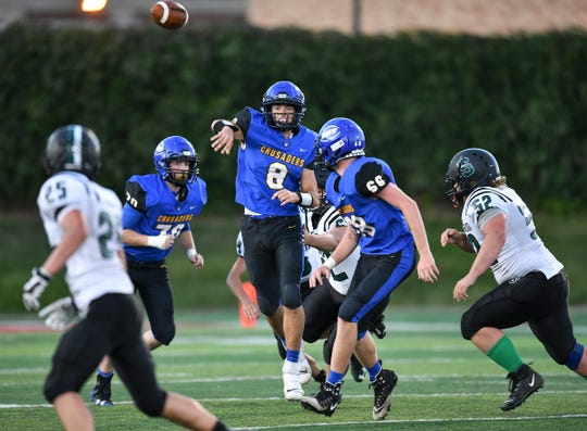 Cathedral quarterback Mason Wolf throws a pass during the Thursday, Aug. 29, 2019, game at Husky Stadium in St. Cloud.
