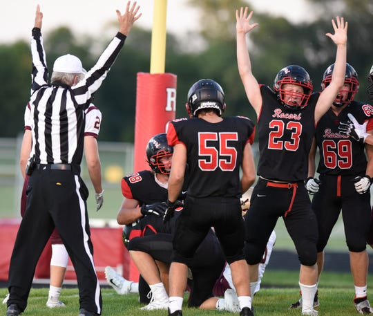 ROCORI junior Luke Humbert (23) is the first to celebrate after Drew Schneider recovers a botched punt for a touchdown against Fergus Falls Thursday, Aug. 29, 2019, at ROCORI High School.