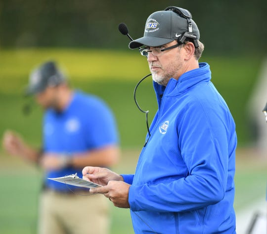 Cathedral head coach Jason Klinefelter watches play during the first half of the Thursday, Aug. 29, 2019, game at Husky Stadium in St. Cloud.