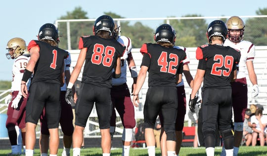 ROCORI Captains Jack Steil, Andrew Anderson, Brock Humbert and Isaac Massmann shake hands with Fergus Falls Thursday, Aug. 29, 2019, at ROCORI High School.