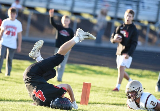 ROCORI junior Brady Linn flips into the end zone to score a touchdown in the first quarter against Fergus Falls Thursday, Aug. 29, 2019, at ROCORI High School.