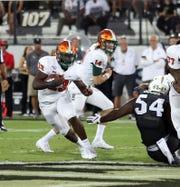 FAMU freshman running back Terrell Jennings looks for an opening versus UCF.