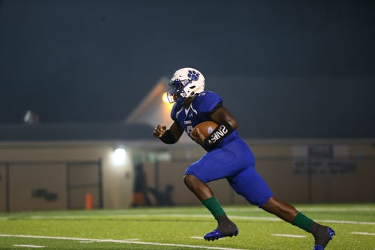 Godby's Jacquez Yant (3) returns a kick during a game between Godby and Trinity Christian at Gene Cox Stadium Thursday, August 29, 2019. Trinity defeated Godby 45-42 in overtime.
