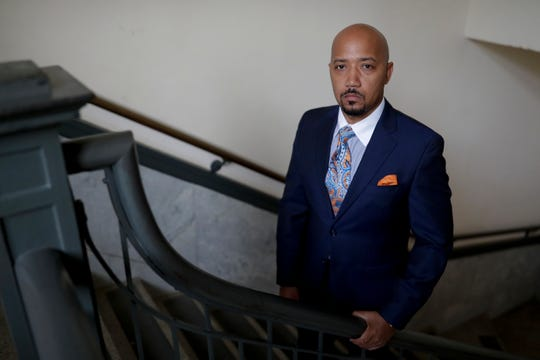 """Charles Gee stands inside the Gadsden County Courthouse in his hometown, Quincy, which is also home to an office of his law practice, Gee & Lee Law. Gee was recently awarded the National Bar Association's Top 40 under 40 award and the group's most prestigious award """"Nation's Best Advocate."""""""