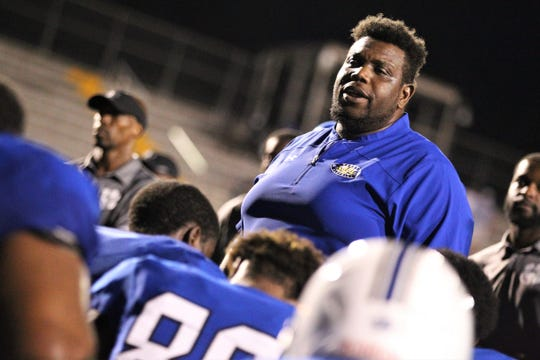 First-year Godby head coach Brandon McCray talks to his team after Trinity Christian beat Godby 45-42 in overtime on Thursday, Aug. 29, 2019.