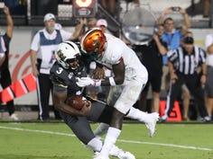 FAMU safety Markquese Bell makes a tackle on UCF quarterback Brandon Wimbush.