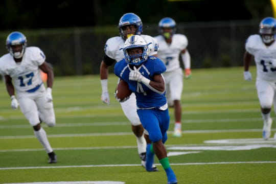 Godby's Alvin Jones (4) takes off on a touchdown reception as Godby and Trinity Christian played at Gene Cox Stadium Thursday, August 29, 2019. Trinity defeated Godby 45-42 in overtime.