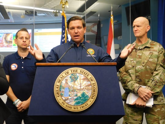 Gov. Ron DeSantis speaks at a morning news briefing in Tallahassee with Jared Moskowitz, director of the state Division of Emergency Management, and Maj. Gen. James Effect, the state adjutant general.