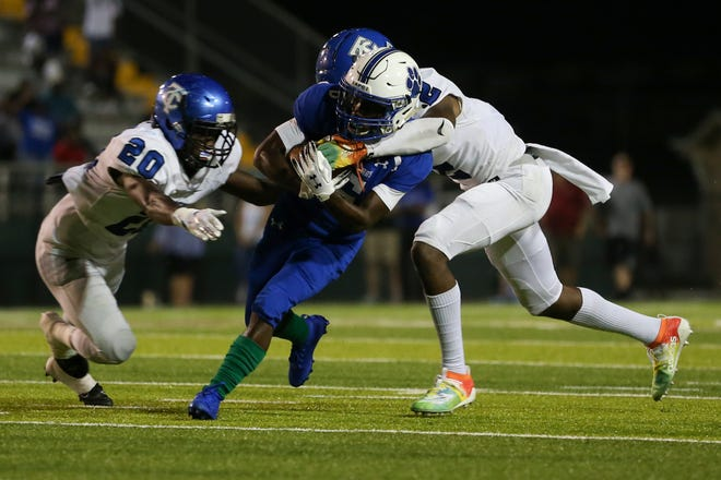 Godby's TreValle Caldwell (6) gets tackled during a game between Godby and Trinity Christian at Gene Cox Stadium Thursday, August 29, 2019. Trinity defeated Godby 45-42 in overtime.