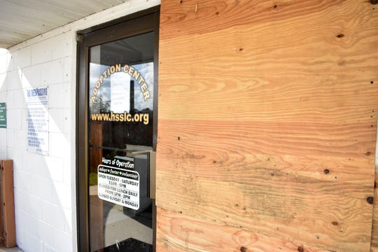 The exterior of the Fort Pierce, Fla., branch of the Humane Society of St. Lucie County is partially boarded up ahead of Hurricane Dorian, Thursday, Aug. 29, 2019.