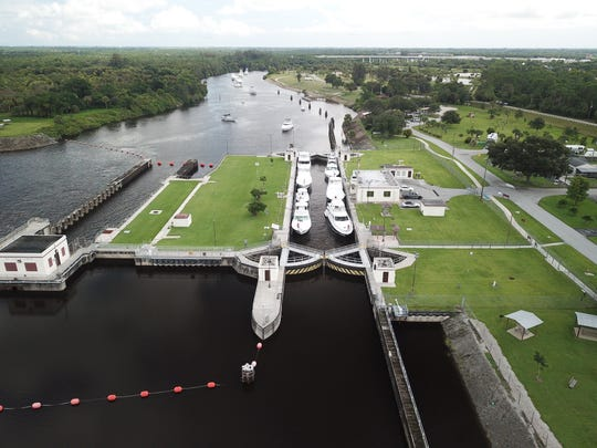 Seven boats transit the lock at St. Lucie Lock and Dam in western Martin County Thursday while nearly a dozen more await their turn in the south fork of the St. Lucie River. Boaters were moving vessels inland to protect them from Hurricane Dorian.