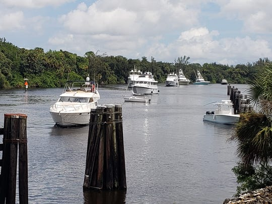 Boats stage on the St. Lucie River side of the St. Lucie Lock waiting their turns to lock through into the Okeechobee Waterway and head west, away from the storm.
