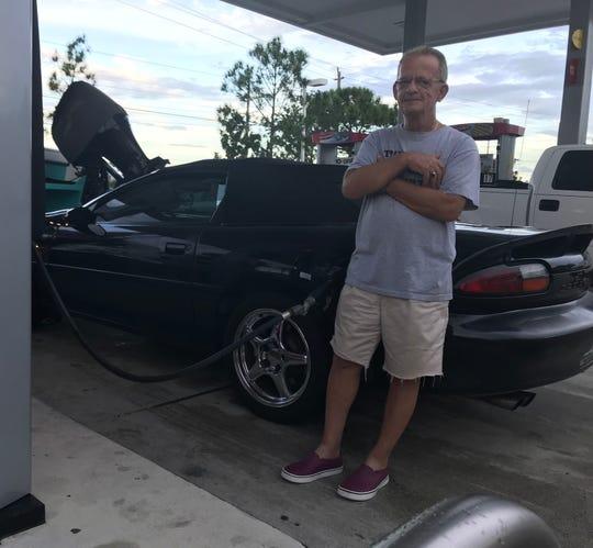 Gil Shapiro fills up his Chevrolet Camaro
