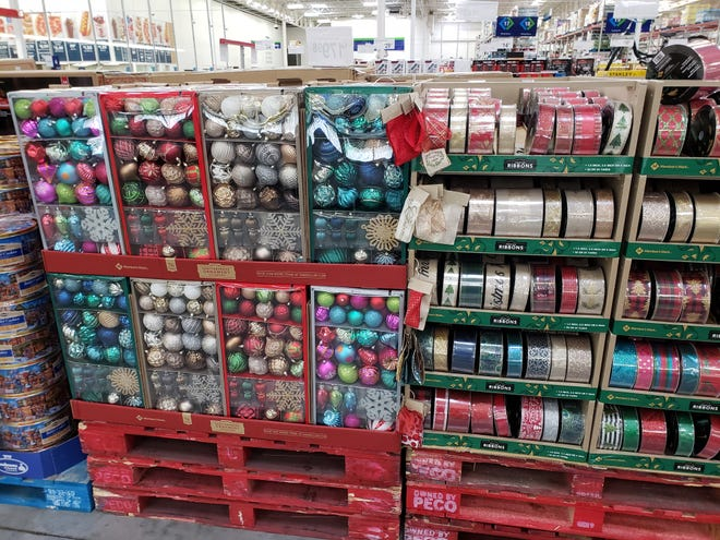 Christmas ornaments, ribbon, wrapping and even artificial Christmas trees were available for purchase at Sam's Club as Floridians stocked up on hurricane supplies pre-Dorian.