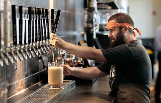 Flix Brewhouse lead brewer Scott Plachecki primes a tap as the theater prepares to open in West El Paso.
