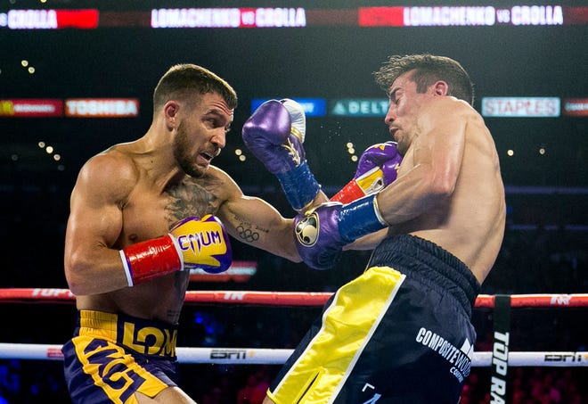 Vasiliy Lomachenko, left, hits Anthony Crolla during his knockout victory at Staples Center on April 12, 2019.