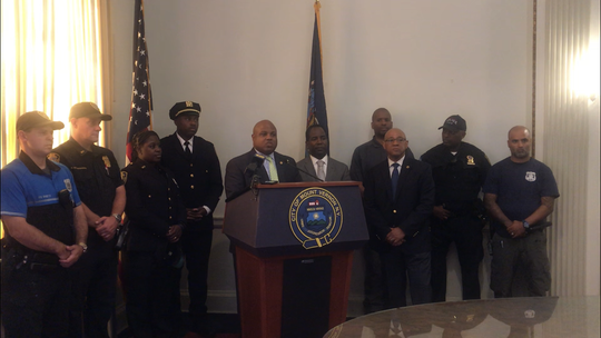 "Mount Vernon Police Commissioner Shawn Harris, standing at the podium between Lt. Steven Sexton and Mayor Andre Wallace, announcing Sexton's appointment as head of internal affairs and a stepped up effort by that unit to weed out ""waste, fraud and abuse"" in the department, particularly as it applies to overtime spending."