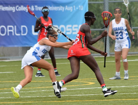 New Rochelle resident Ryan Lipton (l) defends against Kenyan player while playing for Israel in the 2019 U19 World Championships in Ontario, Canada.