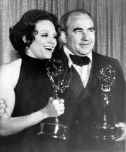 In this May 9, 1971 file photo, Actress Valerie Harper, left, and actor Ed Asner pose with their Emmy statuettes at the annual Primetime Emmy Awards presentation in Los Angeles, Calif. Valerie Harper, who scored guffaws and stole hearts as Rhoda Morgenstern on back-to-back hit sitcoms in the 1970s, has died, Friday, Aug. 30, 2019. She was 80.