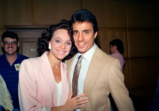 """In this Sept. 16, 1988 file photo, Actress Valerie Harper, left, and her husband, Tony Cacciotti, hug and smile after a jury decided in her favor against Lorimar Telepictures Corp. in a dispute that ended her role in the """"Valerie"""" television series, in Los Angeles. Valerie Harper, who scored guffaws and stole hearts as Rhoda Morgenstern on back-to-back hit sitcoms in the 1970s, has died, Friday, Aug. 30, 2019. She was 80."""