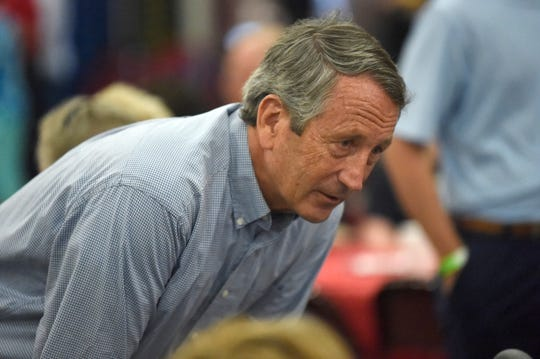 FILE - In this Aug. 26, 2019, file photo, former Rep. Mark Sanford speaks with attendees at Rep. Jeff Duncan's annual fundraiser in Anderson, S.C. Sanford is considering a challenge to President Donald Trump, and while he's acknowledging he faces long odds, he also says he's survived long odds in his past political career. (AP Photo/Meg Kinnard)