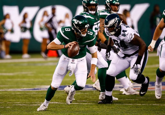 Luke Falk of the New York Jets rolls out in front of Keegan Ridgeway during a preseason game against the Eagles in August.