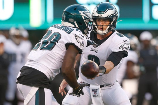 Philadelphia Eagles quarterback Clayton Thorson (8) hands the ball to running back Wendell Smallwood (28) during the first half of a preseason NFL football game against the New York Jets Thursday.