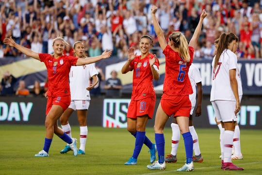 United States' Morgan Brian (6), Carli Lloyd (10) and Lindsey Horan (9) celebrate after a goal by Brian during the first half of the team's international friendly soccer match against Portugal, Thursday, Aug. 29, 2019, in Philadelphia.