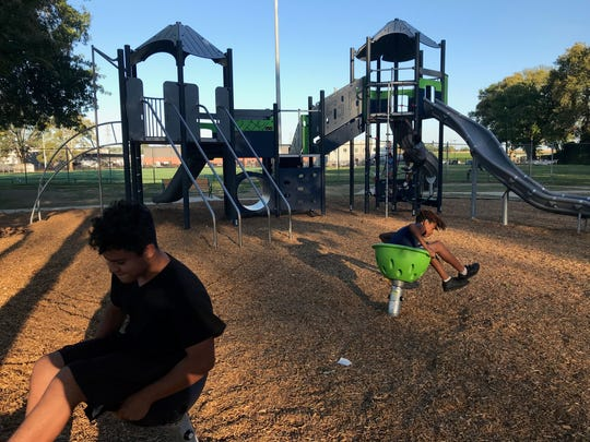 Two kids that live near Eden Park take a spin in the new Wilmington playground.