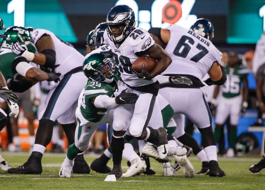 New York Jets' Sojourn Shelton (39) tackles Philadelphia Eagles' Wendell Smallwood (28) during the first half of a preseason NFL football game Thursday, Aug. 29, 2019, in East Rutherford, N.J.