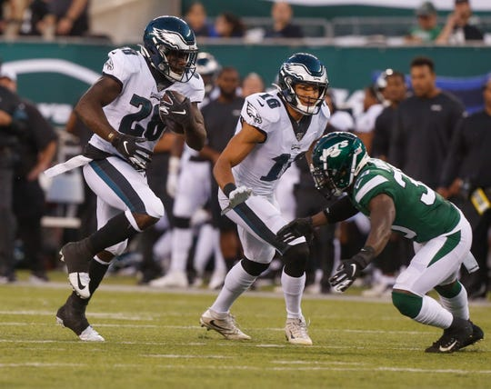 Philadelphia Eagles' Wendell Smallwood (28) rushes past New York Jets' Doug Middleton (36) during the first half of a preseason NFL football game Thursday, Aug. 29, 2019, in East Rutherford, N.J.