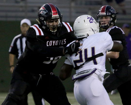 Wichita Falls High's Anthony Vargas blocks Chisholm Trail's Jae'Marcus Allen Thursday, Aug. 29, 2019, at Memorial Stadium.