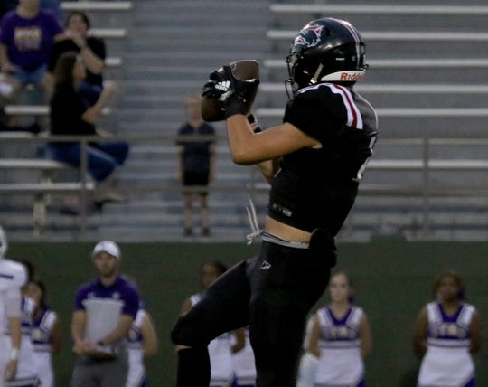 Wichita Falls High's Zach Williams makes the catch against Chisholm Trail Thursday, Aug. 29, 2019, at Memorial Stadium.