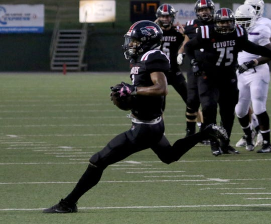 Wichita Falls High's Tre McKenzie runs after the catch against Chisholm Trail Thursday, Aug. 29, 2019, at Memorial Stadium.